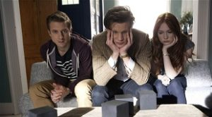 Programme Name: Doctor Who - TX: 22/09/2012 - Episode: The Power of Three (No. 4) - Embargoed for publication until: 18/09/2012 - Picture Shows: behind-the-scenes shot Rory Williams (ARTHUR DARVILL), The Doctor (MATT SMITH), Amy Pond (KAREN GILLAN) - (C) BBC - Photographer: Adrian Rogers